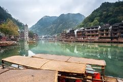 Boats on the Tuojiang River, Fenghuang Ancient Town, China. FENGHUANG, CHINA - NOV 11, 2014 - Boats on the Tuojiang River, Fenghuang Ancient Town, China royalty free stock images