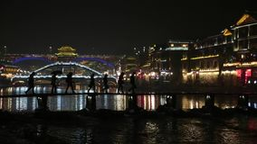 Fenghuang China Silhouette Bridge Crossing at Night Lightshow stock video