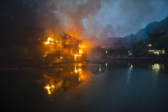 Fenghuang, Hunan fire. 2013, Fenghuang County, Hunan Province, a Qing Dynasty building on fire Stock Image