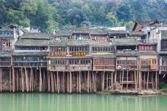 Traditional stilt houses on the Tuojiang River, Fenghuang, China. FENGHUNG, CHINA - NOV 12, 2014 - Traditional stilt houses on the Tuojiang River, Fenghuang royalty free stock image