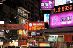 Fengjia Night Market.Taiwan. A variety of signs for shops, restaurants, hub,spas, and internet cafes hang out of buildings. famous Fengjia Night Market.Taiwan royalty free stock photo