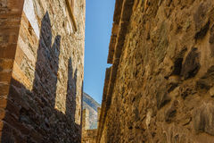 FENIS,ITALIA-5 SEPTEMBER.The facade of the castle of Fenis in Aosta Valley with its city walls and its  defensive towers. The shadows  of the  battlements Royalty Free Stock Photography
