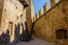 FENIS,ITALIA- 5 SEPTEMBER .The facade of the castle of Fenis. The shadows  of the  battlements   drawn on the towers illuminated  by  the  sun  of the castle of Royalty Free Stock Photos