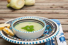 Fennel cream soup in the traditional tunisian plate Stock Photography