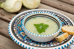 Fennel cream soup in the traditional tunisian plate Stock Image
