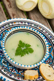 Fennel cream soup in the traditional tunisian plate Royalty Free Stock Images
