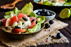 Fennel salad with grapefruit, apple, stalk celery and olives Stock Image