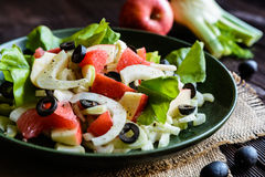 Fennel salad with grapefruit, apple, stalk celery and olives Royalty Free Stock Photos