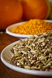 Fennel seeds and dry orange rind, portrait Stock Photos