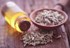 Fennel seeds with essential oil. In a bottle on natural surface Stock Image