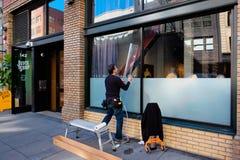 Fenster-Abziehbild-Aufkleber-Arbeitskraft Lizenzfreies Stockbild