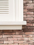 Fenster auf Backsteinmauer Lizenzfreie Stockfotos