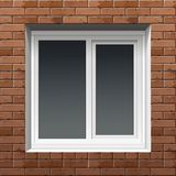 Fenster auf einer Backsteinmauer Stockfotografie