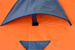 Fenster des orange Zeltes Lizenzfreie Stockfotografie