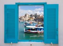 Fenster mit altem Hafen von Iraklio, Kreta, Griechenland Lizenzfreie Stockfotografie