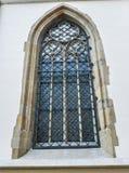 Fenster mit Schmiedeeisenstangen stockfotografie