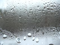 Fensterglas- und -regentropfen Stockbild
