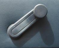 Fensterwinde in einem Auto Stockbild