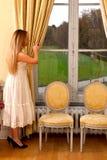 Fenêtre de château de femme Photographie stock