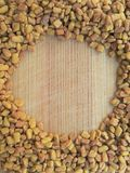 Fenugreek circle on wooden background Stock Images