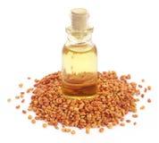 Fenugreek with oil in bottle Stock Photography