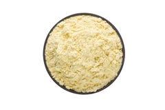 Fenugreek powder in clay bowl isolated on white background. Seas Stock Photo