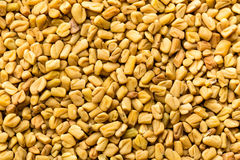 Fenugreek seeds background, spice, culinary ingredient Stock Image