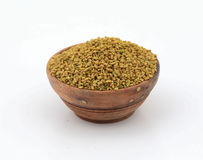 Fenugreek seeds. In a glass bowl on white stock photos