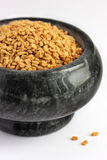 Fenugreek in a stone bowl Royalty Free Stock Photos