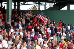 Fenway Faithful. Boston Red Sox fans stand during the National Anthem Stock Images