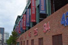 Fenway Park with Retired Numbers. Retired player`s numbers hang outside of Fenway Park where the Boston Red Sox play. Situated in downtown Boston, they are there royalty free stock photo