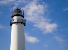 Fenwick Island Lighthouse. Exterior of Fenwick Island Lighthouse with blue sky and cloudscape background, Delaware, U.S.A Stock Photography