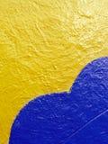 Fer peint jaune et bleu Photo stock