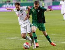 Ferencvaros - Paks OTP Bank League football match. BUDAPEST, HUNGARY - APRIL 6, 2016: Dominik Nagy of Ferencvaros (l) battles for the ball with JanosHahn of Royalty Free Stock Image