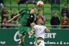 Ferencvaros - Paks OTP Bank League football match. BUDAPEST, HUNGARY - APRIL 6, 2016: Roland Varga of Ferencvaros (r) duels for the ball with Janos Szabo of Paks Royalty Free Stock Photography