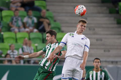 Ferencvaros vs. Bekescsaba OTP Bank League football match. BUDAPEST, HUNGARY - SEPTEMBER 19, 2015: Air battle between Zoltan Gera of Ferencvaros (l) and Adam Stock Photography