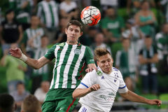 Ferencvaros vs. Bekescsaba OTP Bank League football match. BUDAPEST, HUNGARY - SEPTEMBER 19, 2015: Air battle between Zoltan Gera of Ferencvaros (l) and Adam Royalty Free Stock Image