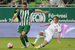 Ferencvaros vs. Bekescsaba OTP Bank League football match. BUDAPEST, HUNGARY - SEPTEMBER 19, 2015: Daniel Bode of Ferencvaros (l) tries to shoot beside Zsolt Royalty Free Stock Photo