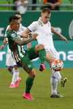 Ferencvaros vs. Bekescsaba OTP Bank League football match. BUDAPEST, HUNGARY - SEPTEMBER 19, 2015: Duel between Cristian Ramirez of Ferencvaros (l) and Balazs royalty free stock photography
