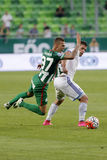Ferencvaros vs. Bekescsaba OTP Bank League football match. BUDAPEST, HUNGARY - SEPTEMBER 19, 2015: Roland Varga of Ferencvaros (l) is pulled down by Balint Royalty Free Stock Image