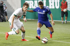 Ferencvaros vs. Chelsea stadium opening football match. BUDAPEST, HUNGARY - AUGUST 10, 2014: Michal Nalepa (l) of FTC and Eden Hazard of Chelsea during Royalty Free Stock Images