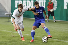 Ferencvaros vs. Chelsea stadium opening football match. BUDAPEST, HUNGARY - AUGUST 10, 2014: Michal Nalepa (l) of FTC and Eden Hazard of Chelsea during Stock Photography