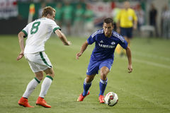 Ferencvaros vs. Chelsea stadium opening football match. BUDAPEST, HUNGARY - AUGUST 10, 2014: Tomislav Hajovic of FTC (l) and Eden Hazard of Chelsea during Stock Image