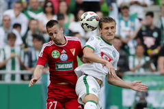 Ferencvaros vs. DVSC OTP Bank League football match. BUDAPEST, HUNGARY - MAY 10, 2015: Air battle between Emir Dilaver of Ferencvaros (r) and Adam Bodi of DVSC Stock Photography