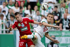 Ferencvaros vs. DVSC OTP Bank League football match. BUDAPEST, HUNGARY - MAY 10, 2015: Air battle between Emir Dilaver of Ferencvaros (r) and Adam Bodi of DVSC Stock Photos