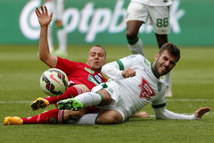 Ferencvaros vs. DVSC OTP Bank League football match. BUDAPEST, HUNGARY - MAY 10, 2015: Duel between Gabor Gyomber of Ferencvaros (r) and Peter Szakaly of DVSC Royalty Free Stock Photo