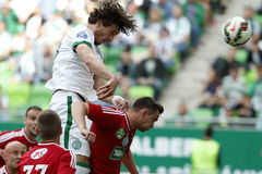 Ferencvaros vs. DVSC OTP Bank League football match. BUDAPEST, HUNGARY - MAY 10, 2015: Mateo Pavlovic of Ferencvaros (l) heads a goal next to Adam Bodi of DVSC Royalty Free Stock Photo