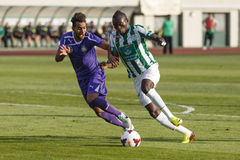 Ferencvaros vs. Ujpest OTP Bank League football match. BUDAPEST - SEPTEMBER 22: Ulysse Diallo of FTC (R) overtakes Lucien Ngawa of UTE during Ferencvaros vs Royalty Free Stock Photography