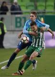 Ferencvarosi TC v Paksi FC - Hungarian OTP Bank Liga  1-2. BUDAPEST, HUNGARY - NOVEMBER 5, 2016: Adam Pinter #17 of Ferencvarosi TC fights for the ball with Stock Photos