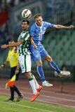 Ferencvarosi TC vs. HNK Rijeka UEFA EL football match. BUDAPEST, HUNGARY - JULY 24, 2014: Air battle between Philipp Bonig of FTC (l) and Vedran Jugovic of stock photography